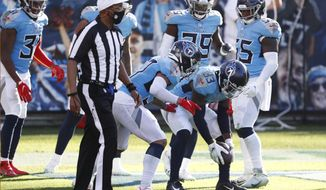 Tennessee Titans cornerback Desmond King (33) celebrates after he returned a fumble recovery 63 yards for a touchdown against the Chicago Bears in the second half of an NFL football game Sunday, Nov. 8, 2020, in Nashville, Tenn. (AP Photo/Ben Margot)