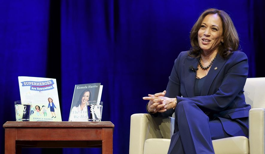 FILE  - Kicking off her book tour, Sen. Kamala Harris, D-Calif. speaks at George Washington University in Washington, in this Wednesday, Jan. 9, 2019, file photo. Books by and about Kamala Harris are proving to be a popular purchase following the election. The Vice President-elect is the subject or author of four books on the Amazon top 10 Sunday, Nov. 8, 2020. (AP Photo/Sait Serkan Gurbuz, File)