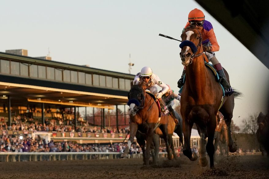 John Velazquez, right, rides Authentic to win the Breeder's Cup Classic horse race at Keeneland Race Course, in Lexington, Ky., Saturday, Nov. 7, 2020. (AP Photo/Darron Cummings) **FILE**