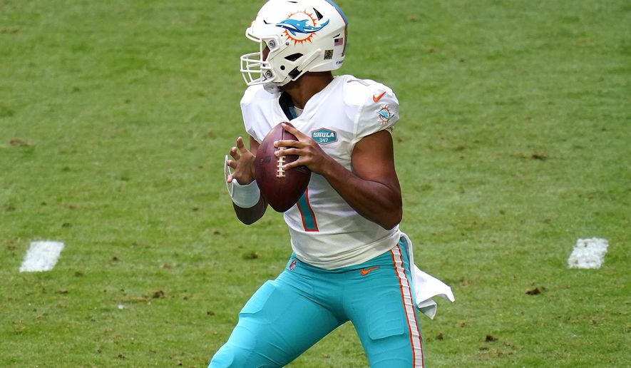 Miami Dolphins quarterback Tua Tagovailoa (1) looks to pass against the Arizona Cardinals during the first half of an NFL football game, Sunday, Nov. 8, 2020, in Glendale, Ariz. (AP Photo/Ross D. Franklin)