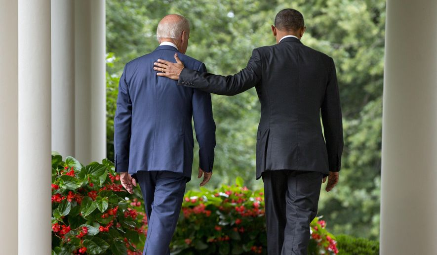 President Barack Obama walks with Vice President Joe Biden back to the Oval Office of the White House in Washington, Thursday, June 25, 2015, after speaking in the Rose Garden. (AP Photo/Pablo Martinez Monsivais)