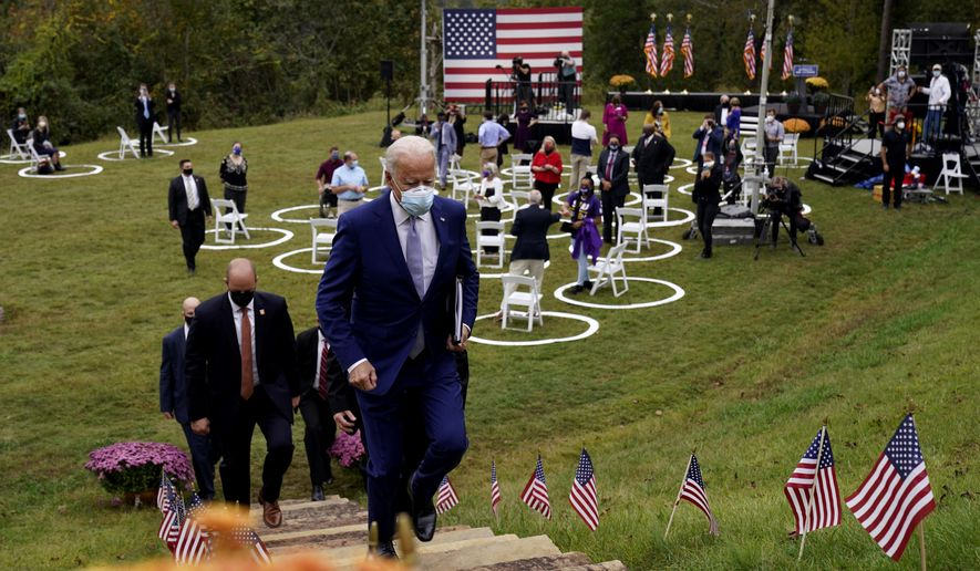 Democratic presidential candidate former Vice President Joe Biden leaves after speaking at Mountain Top Inn & Resort, Tuesday, Oct. 27, 2020, in Warm Springs, Ga. (AP Photo/Andrew Harnik)