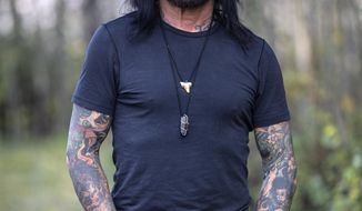 Motley Crue bassist Nikki Sixx stands for a portrait Thursday, Sept. 17, 2020, outside his home in Jackson, Wyo. Sixx and his family moved from Los Angeles to Jackson Hole earlier this year, where he hopes to become a leading voice for addiction and recovery in his new hometown. (Ryan Dorgan/Jackson Hole News & Guide via AP, File)