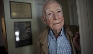 """Veteran John Waller, who served in Europe during WWII, poses at his home, Thursday, Sept. 24, 2020, Virginia Beach, Va. The 96-year-old World War II veteran is featured in a new documentary, """"The Silent Soldier and the Portrait,"""" produced by his daughter Garland. It delves into two secrets he kept since his war days. (Stephen M. Katz/The Virginian-Pilot via AP)"""