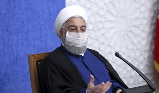 """In this photo released by the official website of the office of the Iranian Presidency, President Hassan Rouhani speaks in a meeting in Tehran, Iran, Sunday, Nov. 8, 2020. On Sunday, Rouhani called on President-elect Joe Biden to """"compensate for past mistakes"""" and return the U.S. to Tehran's 2015 nuclear deal with world powers. (Iranian Presidency Office via AP)"""