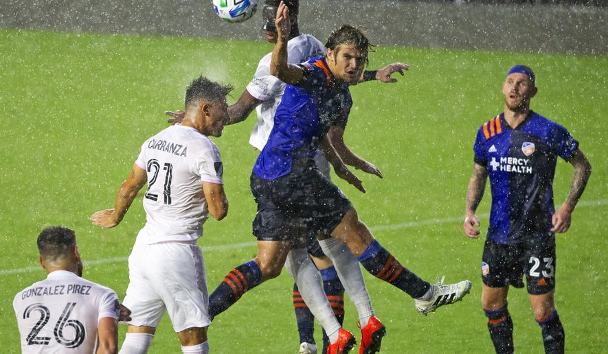 Inter Miami forward Julian Carranza (21) jumps for the ball with FC Cincinnati defender Nick Hagglund (14) during the second half of an MLS soccer match Sunday, Nov. 8, 2020, in Fort Lauderdale, Fla. (David Santiago/Miami Herald via AP)