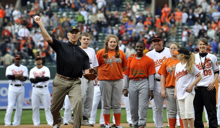 In this April 6, 2009, file photo, then-Vice President Joe Biden throws out the first pitch prior to the Baltimore Orioles and the New York Yankees opening day baseball game at Camden Yards in Baltimore. (AP Photo/Gail Burton, File)  **FILE**