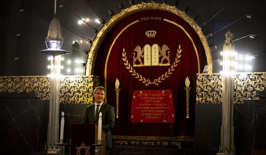 """Rene de Reuver, speaking on behalf of the General Synod of the Protestant Church in the Netherlands, reads a statement at the Rav Aron Schuster Synagogue in Amsterdam, Netherlands, Sunday, Nov. 8, 2020.The Dutch Protestant Church made a far-reaching confession of guilt Sunday for its failure to do more to help Jews during and after World War II and even for the church's role in preparing """"the ground in which the seeds of anti-Semitism and hatred could grow."""" The statement came at a solemn ceremony to mark Monday's anniversary of the Nazis' anti-Jewish Kristallnacht, or """"Night of Broken Glass,"""" pogrom in Germany and Austria. (AP Photo/Peter Dejong)"""