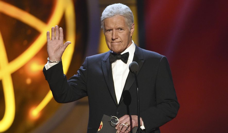 Alex Trebek gestures while presenting an award at the 46th annual Daytime Emmy Awards in Pasadena, Calif. (Photo by Chris Pizzello/Invision/AP, File)