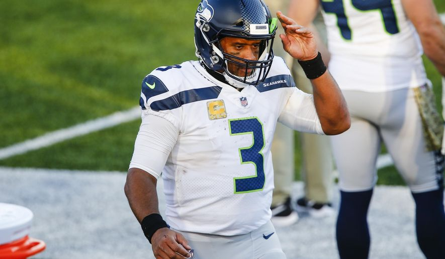 Seattle Seahawks quarterback Russell Wilson (3) reacts during the second half of an NFL football game against the Buffalo Bills Sunday, Nov. 8, 2020, in Orchard Park, N.Y. (AP Photo/John Munson)