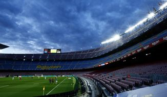 A general view shows the players of Barcelona and Betis during the Spanish La Liga soccer match between FC Barcelona and Betis at the Camp Nou stadium in Barcelona, Spain, Saturday, Nov. 7, 2020. (AP Photo/Joan Monfort)
