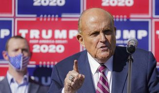 Former New York mayor Rudy Giuliani, a lawyer for President Donald Trump, speaks during a news conference at Four Seasons Total Landscaping on legal challenges to vote counting in Pennsylvania, Saturday Nov. 7, 2020, in Philadelphia. **FILE**
