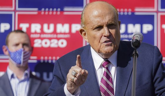 Former New York mayor Rudy Giuliani, a lawyer for President Donald Trump, speaks during a news conference at Four Seasons Total Landscaping on legal challenges to vote counting in Pennsylvania, Saturday Nov. 7, 2020, in Philadelphia.