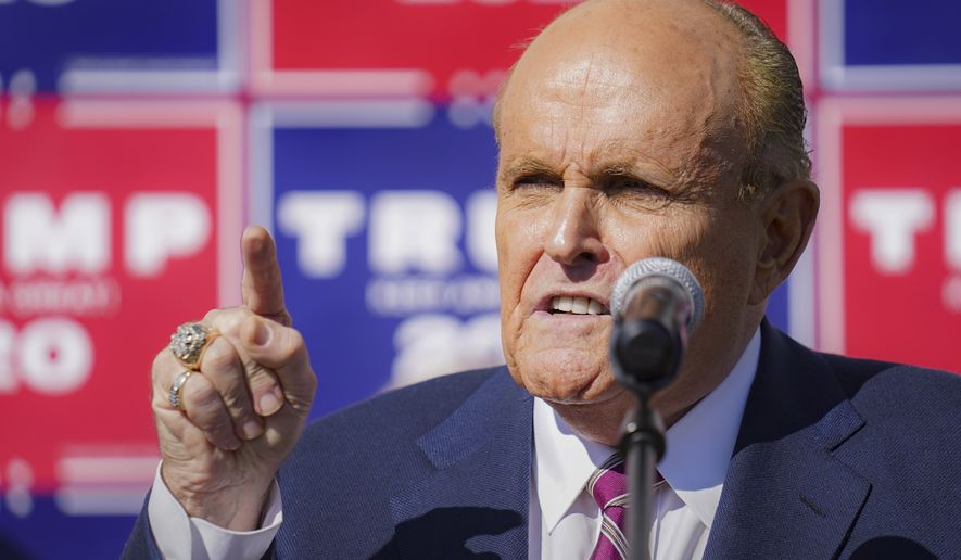 Former New York mayor Rudy Giuliani, a lawyer for President Donald Trump,speaks during a news conference at Four Seasons Total Landscaping on legal challenges to vote counting in Pennsylvania, Saturday Nov. 7, 2020, in Philadelphia.