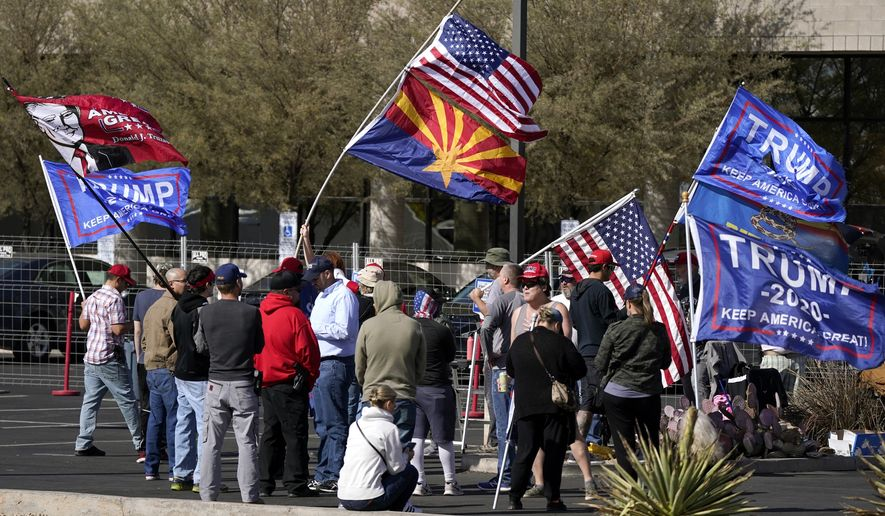 Supporters of President Donald Trump rally in front of the Maricopa County Recorder's Office as the votes continue to be counted, Monday, Nov. 9, 2020, in Phoenix. (AP Photo/Ross D. Franklin)