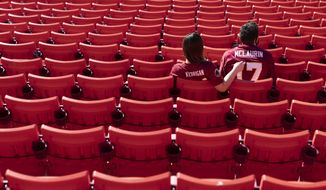 Fans in their seats at FedEx Field before the start of an NFL football game between the New York Giants and Washington Football Team, Sunday, Nov. 8, 2020, in Landover, Md. (AP Photo/Patrick Semansky)