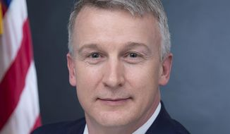 In this image provided by Public Health Emergency, a department of Health and Human Services, Rick Bright is shown in his official photo on April 27, 2017, in Washington. Bright has been named by President-elect Joe Biden as a member of his COVID-19 advisory board.  (Health and Human Services via AP)
