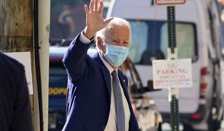 President-elect Joe Biden waves as he arrives Monday, Nov. 9, 2020, at The Queen theater in Wilmington, Del. (AP Photo/Carolyn Kaster)