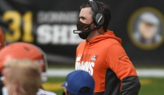 Cleveland Browns head coach Kevin Stefanski watches from the sideline as his team plays against the Pittsburgh Steelers during the first half of an NFL football game, Sunday, Oct. 18, 2020, in Pittsburgh. (AP Photo/Don Wright)