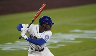 CORRECTS SECOND SENTENCE - FILE - In this Aug. 23, 2020, file photo, Seattle Mariners' Kyle Lewis begins his swing on a solo home run against the Texas Rangers during the first inning of a baseball game in Seattle. Lewis won the AL Rookie of the Year award on Monday, Nov. 9, 2020. (AP Photo/Ted S. Warren, File)  **FILE**