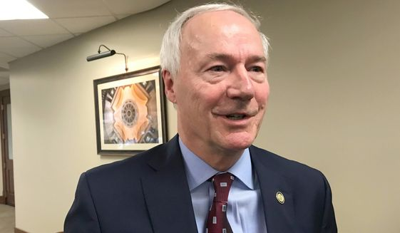 In this Jan. 13, 2020, file photo, Arkansas Gov. Asa Hutchinson speaks to reporters in Little Rock, Ark. Hutchinson isn't on the ballot in Tuesday's election but he's still a major player in it. The governor has appeared in an ad for fellow Republican Rep. French Hill, who's in an unexpectedly tight reelection fight. (AP Photo/Andrew Demillo, File)