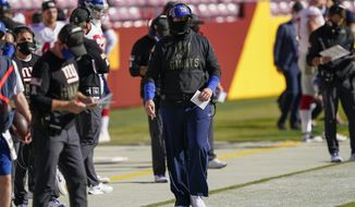 New York Giants head coach Joe Judge following the game action in the first half of an NFL football game against the 142Washington Football Team, Sunday, Nov. 8, 2020, in Landover, Md. (AP Photo/Al Drago)