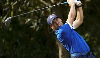 Sergio Garcia, of Spain, watches his tee shot on the first hole during the first round of the Houston Open golf tournament Thursday, Nov. 5, 2020, in Houston. (AP Photo/David J. Phillip)