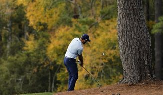 Dustin Johnson hits out of the rough on the third fairway during a practice round for the Masters golf tournament Monday, Nov. 9, 2020, in Augusta, Ga. (AP Photo/Matt Slocum)  *FILE**