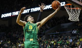 FILE - In this March 7, 2020, file photo, Oregon guard Will Richardson (0) lays in a basket against Stanford during the first half of an NCAA college basketball game in Eugene, Ore. Oregon has been the Pac-12's gold standard, winning four regular-season and three conference tournament titles the past five years. (AP Photo/Thomas Boyd, File)