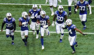 Indianapolis Colts inside linebacker Bobby Okereke (58) celebrates with teammates after recovering a fumble against the Baltimore Ravens in the second half of an NFL football game in Indianapolis, Sunday, Nov. 8, 2020. (AP Photo/AJ Mast)