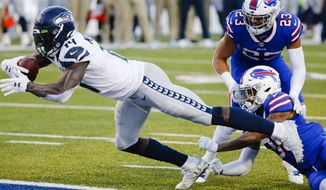 Seattle Seahawks' DK Metcalf (14) dives for a touchdown as Buffalo Bills' Dane Jackson (30) attempts to tackle him during the second half of an NFL football game Sunday, Nov. 8, 2020, in Orchard Park, N.Y. (AP Photo/Jeffrey T. Barnes)