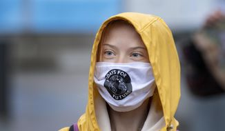Swedish climate activist Greta Thunberg attends a Fridays For Future protest outside the Swedish Parliament, in Stockholm, Sweden, Friday, Oct. 9, 2020. (Jessica Gow/TT via AP) ** FILE **