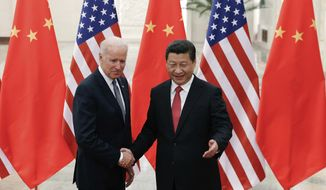 As vice president, Joseph R. Biden visited Chinese President Xi Jinping in Beijing. He called for intimate U.S. economic and trade integration with the emerging communist power. (Associated Press/File)