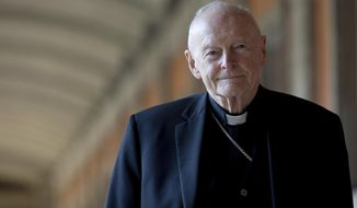 """FILE - In this Feb. 13, 2013 file photo, Cardinal Theodore Edgar McCarrick poses for a photo in Rome. The Vatican on Tuesday will release its long-awaited report into what it knew about ex-Cardinal Theodore McCarrick's sexual misconduct during his rise through the church hierarchy. The Vatican said Friday, Nov. 6, 2020 the report would span McCarrick's entire life, from his birth in 1930 to the 2017 allegations that brought about his downfall. The Vatican said the report would cover """"the Holy See's institutional knowledge and decision-making process"""" as he rose through the church's ranks. (AP Photo/Andrew Medichini, File)"""