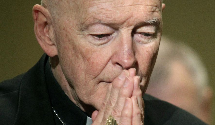 """FILE - In this Nov. 14, 2011, file photo, then-Cardinal Theodore McCarrick prays during the United States Conference of Catholic Bishops' annual fall assembly in Baltimore. The Vatican on Tuesday will release its long-awaited report into what it knew about ex-Cardinal Theodore McCarrick's sexual misconduct during his rise through the church hierarchy. The Vatican said Friday, Nov. 6, 2020 the report would span McCarrick's entire life, from his birth in 1930 to the 2017 allegations that brought about his downfall. The Vatican said the report would cover """"the Holy See's institutional knowledge and decision-making process"""" as he rose through the church's ranks. (AP Photo/Patrick Semansky, File)"""