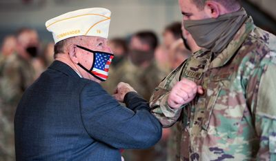 American Legion State Commander Ron Larose and Northern Area Commander Tom Scanlon share an elbow bump after honoring airmen with the 158th Fighter Wing, Vermont Air National Guard. (Air National Guard)