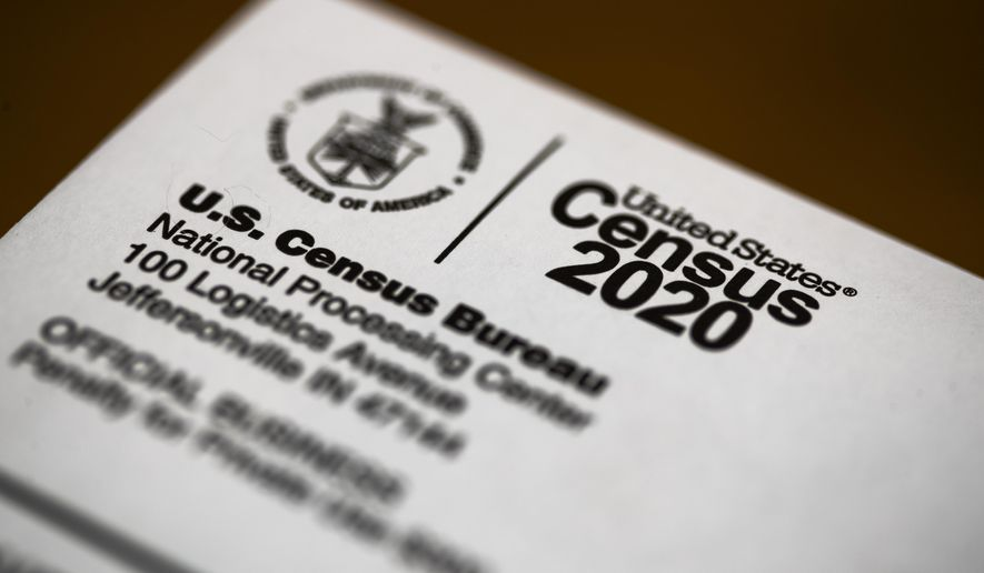 FILE - This March 19, 2020, file photo, shows an envelope containing a 2020 census letter mailed to a U.S. resident. The U.S. Census Bureau has denied any attempts to systemically falsify information during the 2020 head count used to determine the allocation of congressional seats and federal spending. The Census Bureau statement was issued Monday night, Nov. 9, in response to reports by The Associated Press of census workers who said they were told by supervisors to enter fake answers on the head-count forms in order to close cases in the waning days of the census. (AP Photo/Matt Rourke, File)