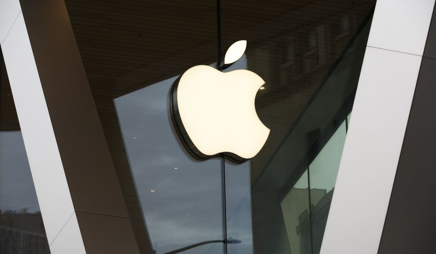 This Saturday, March 14, 2020 file photo shows an Apple logo on the facade of the downtown Brooklyn Apple store in New York. AP Photo/Kathy Willens, File)