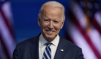 President-elect Joe Biden smiles as he speaks Tuesday, Nov. 10, 2020, at The Queen theater in Wilmington, Del. (AP Photo/Carolyn Kaster)
