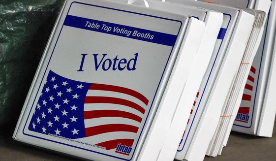 Table top voting booths are stored at the Allegheny County Election Division warehouse on the Northside of Pittsburgh, Friday, Nov. 6, 2020. (AP Photo/Gene J. Puskar)