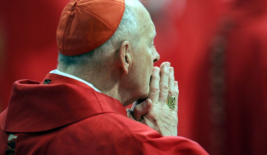 In this April 18, 2005, file photo, U.S. Cardinal Theodore Edgar McCarrick attends a Mass in St. Peter's Basilica at the Vatican, as the cardinals who will elect a new Pope made their last public appearance before sequestering themselves inside the Sistine Chapel later in the day. Thousands of pilgrims and tourists packed St. Peter's Basilica and the square to take a last glimpse at the cardinals who elected the next head of the Roman Catholic Church during the Conclave. (AP Photo/Pier Paolo Cito, File)