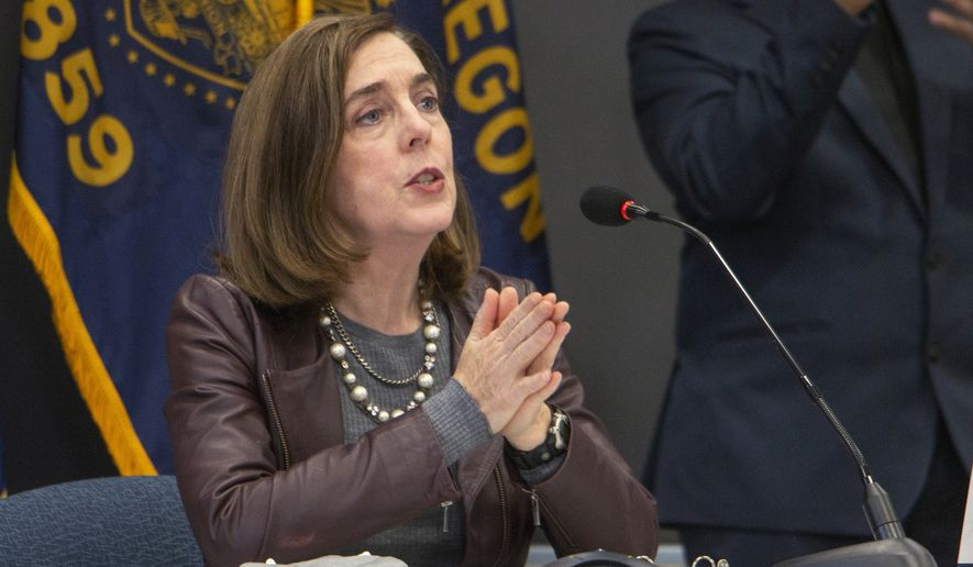 Oregon Gov. Kate Brown speaks Tuesday, Nov. 10, 2020, in Portland, Ore. Brown and Oregon health officials warned Tuesday of the capacity challenges facing hospitals as COVID-19 case counts continue to spike in the state. (Cathy Cheney/Pool Photo via AP)