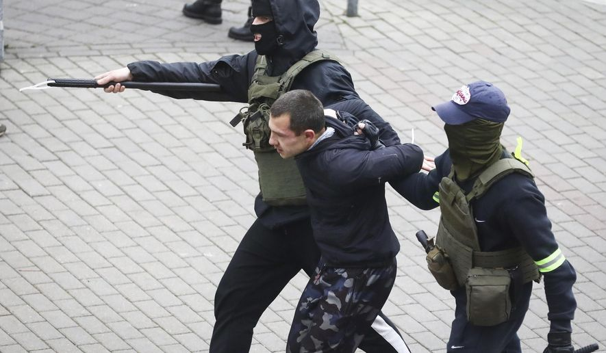 Police detain a man during an opposition rally to protest the official presidential election results in Minsk, Belarus, Sunday, Nov. 8, 2020. Club-swinging police went after demonstrators in the Belarusian capital who were demanding the resignation of the country's authoritarian president on Sunday, the 90th consecutive day of protests in the country. Human rights activists said nearly 400 people were arrested. (AP Photo)