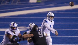 BYU quarterback Zach Wilson has plenty of time to pass with his offensive linemen keeping Boise State's pass rush at bay Friday, Nov. 6, 2020 at Albertsons Stadium in Boise. (AP photo, Darin Oswald/Idaho Statesman via AP)