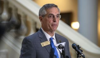 Georgia Secretary of State Brad Raffensperger speaks during a press conference on the third day of early voting at the Georgia State Capitol building in downtown Atlanta, Wednesday, Oct. 14, 2020. (Alyssa Pointer/Atlanta Journal-Constitution via AP) ** FILE **