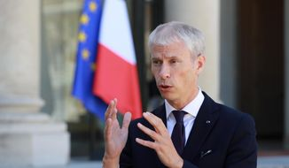"FILE - In this May, 6 ,2020 file photo, then French culture minister Franck Riester makes a statement at the Elysee Palace in Paris. France's trade minister Franck Riester hopes U.S. President-elect Joe Biden acts soon to calm trade tensions fueled by Donald Trump, which have led to escalating tariffs on both sides of the Atlantic hitting billions of dollars worth of wine, cars and other goods. In an interview with The Associated Press, Riester accused the U.S. of blocking the appointment of the World Trade Organization's next director and said France is ""optimistic"" that Biden will improve U.S. ties with Europe and the world. (Ludovic Marin, Pool via AP, File)"