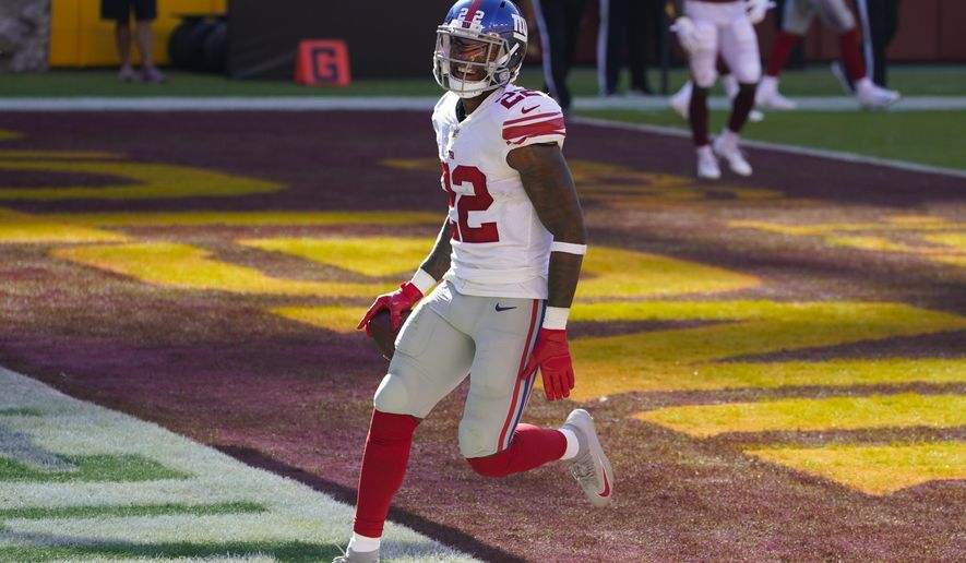 New York Giants running back Wayne Gallman (22) smiles as he scores a touchdown against Washington Football Team in the first half of an NFL football game, Sunday, Nov. 8, 2020, in Landover, Md. (AP Photo/Patrick Semansky)