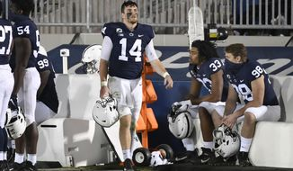 Penn State quarterback Sean Clifford (14) looks at the scoreboard in the last minute of the fourth quarter of an NCAA college football game in State College, Pa., Saturday, Nov. 7, 2020. (AP Photo/Barry Reeger)