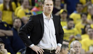 FILE - In this March 5, 2020, file photo, Nebraska head coach Fred Hoiberg watches his team compete against Michigan during the first half of an NCAA college basketball game in Ann Arbor, Mich. Hoiberg did a near total remake of the roster in his first year at Nebraska, and the Cornhuskers finished the season on a school-record 17-game losing streak. (AP Photo/Jose Juarez, File)
