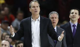 FILE - In this Feb. 18, 2020, file photo, Northwestern head coach Chris Collins reacts during the second half of an NCAA college basketball game against Maryland in College Park, Md. The Wildcats come into their eighth year under Collins looking to get themselves back on the path they appeared to be headed just a few years ago. (AP Photo/Julio Cortez, File)